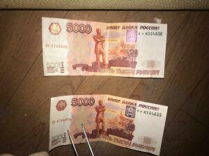 В Казани курьер задержал иностранца, который пытался расплатиться за заказ фальшивкой